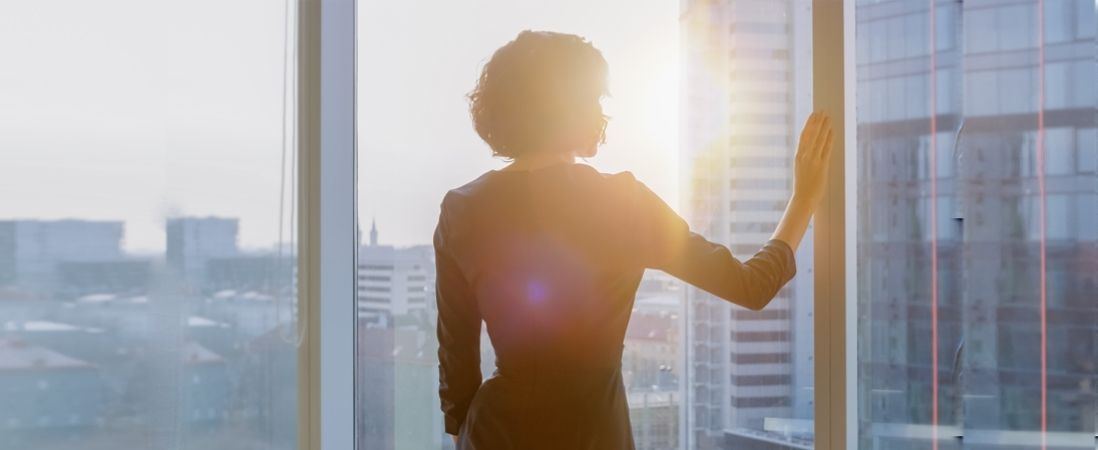 woman looking in the window finding her inner voice as female leader