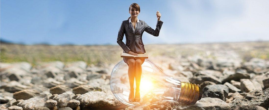 female leader sitting in the bulb light